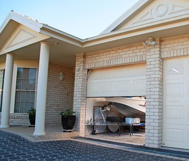 Garage featuring an automatic roller door