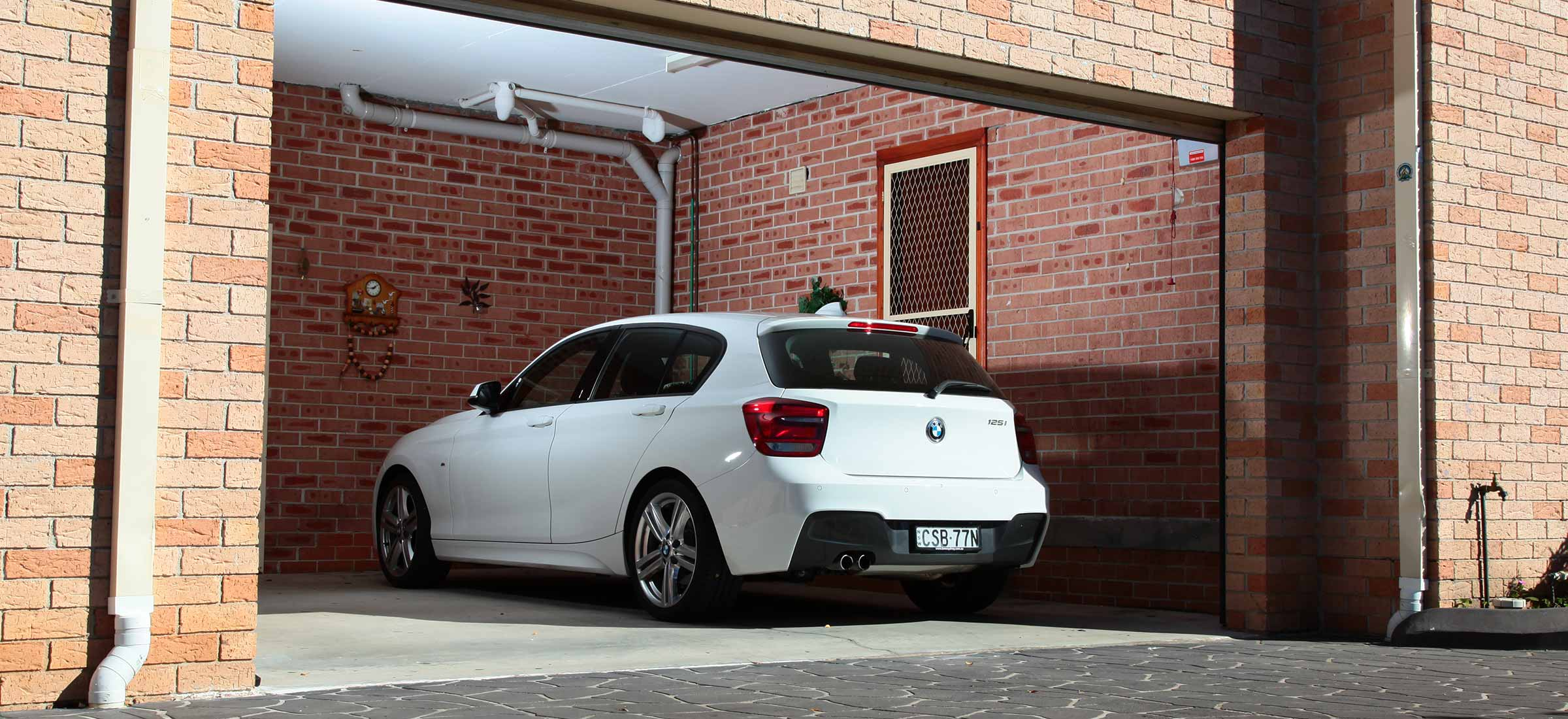 Garage door open with car parked in the garage